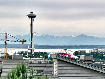 West facing view of the Space Needle and the Olympic mountain range.